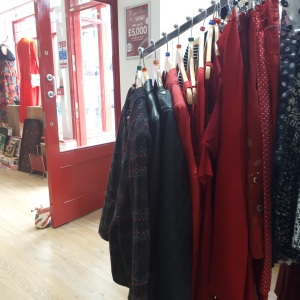 Racks of red & pink clothing in Myton Fargo charity shop || Charity shop shopping with Myton Hospices: adventures in vintage fashion at Myton Fargo, Coventry