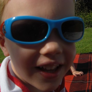 Big Nephew & Big Niece modelling his beloved Thomas The Tank Engine sunglasses, August 2009 || In the shades: the enduring appeal of Ray-Ban sunglasses