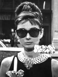 Audrey Hepburn in Ray-Bans during the opening scenes of Breakfast At Tiffany's || In the shades: the enduring appeal of Ray-Ban sunglasses - raeritchie.com