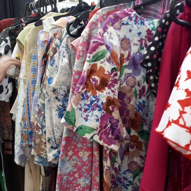 A rack of vintage dresses at Heaven Vintage's Fab Fill A Bag vintage sale in July 2017. Read the blog for about a new way to buy vintage
