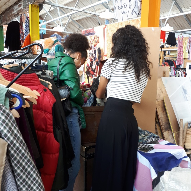 Two customers rummage through the vintage fashion at Heaven Vintage's Fab Fill A Bag sale