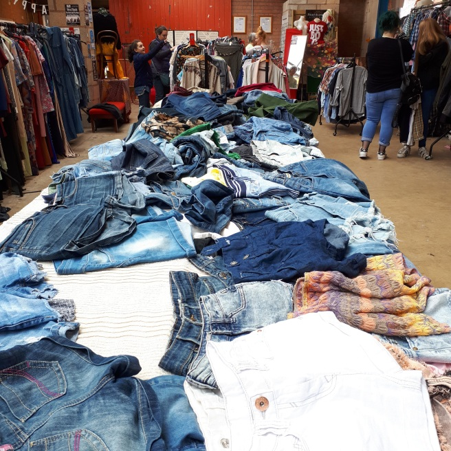 This vintage fashion sale stocks plenty of vintage clothing classics such as the cut offs on this table